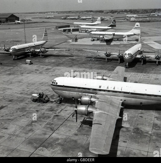 1950s historical picture of different airplanes including a West African Airways Corporation or WAAC Boeing Stratocruiser - Stock Image
