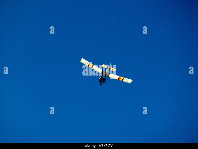 Microlite lightweight single engine aircraft against a blue sky - Stock Image