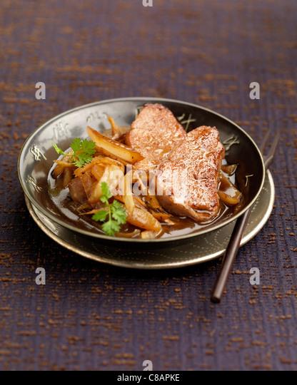 Pork filet mignon sauteed with onions - Stock Image