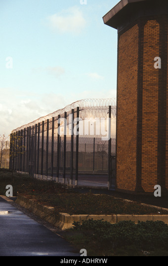 HM Prison Belmarsh, outside London, UK. Building and perimeter fence. - Stock Image