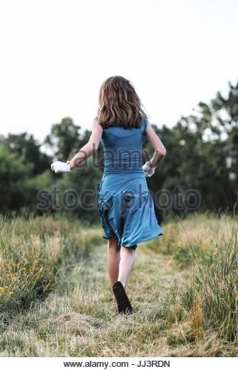 Vintage teen girl running away - Stock Image