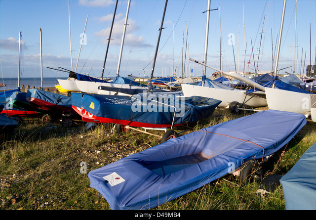 Beached Boats and Dingies Whitstable Sailing Club  Kent England UK - Stock Image