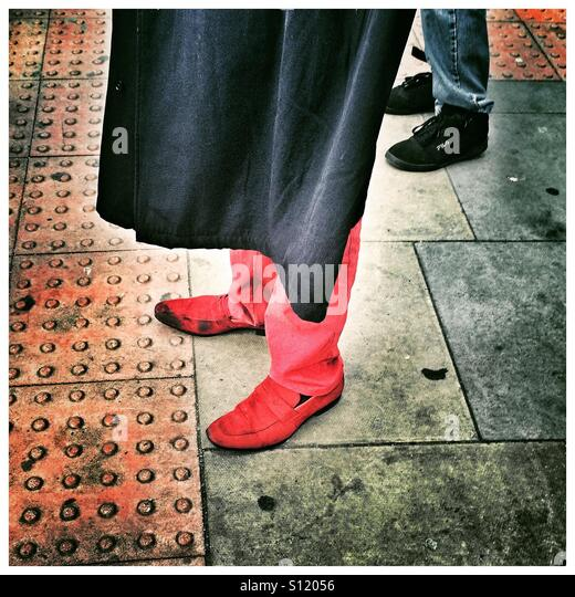 Red shoes and trousers - Stock Image