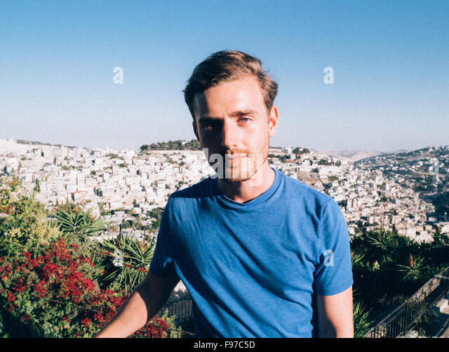 Portrait Of Young Man Against Clear Sky - Stock Image