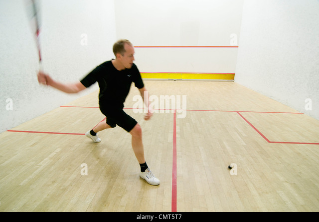 Man playing squash - Stock Image