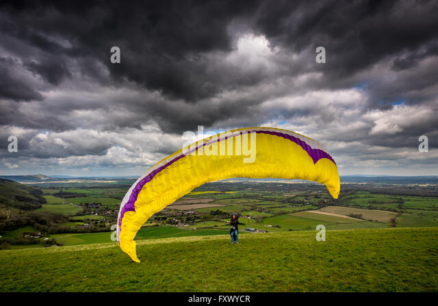 South Downs National Park, UK. 19th April, 2016. UK Weather: A lone parascender launching himself from the top of - Stock Image