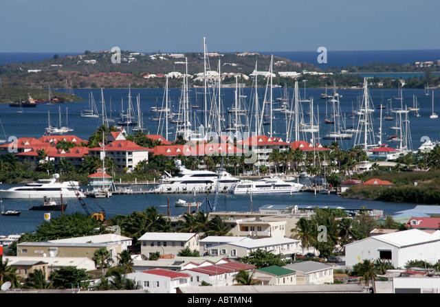 Sint Maarten Dutch Cole Bay buildings boats Simpson Bay - Stock Image