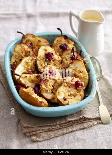 Dish of baked pear and crumble - Stock Image
