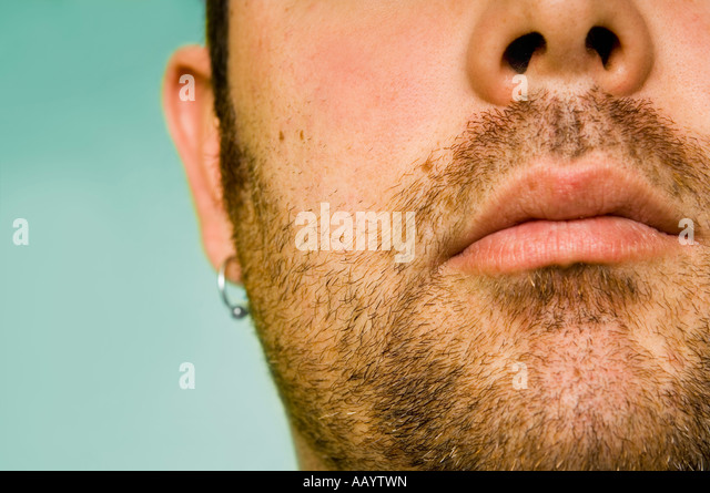 Close up of a mans face with facial hair. - Stock Image