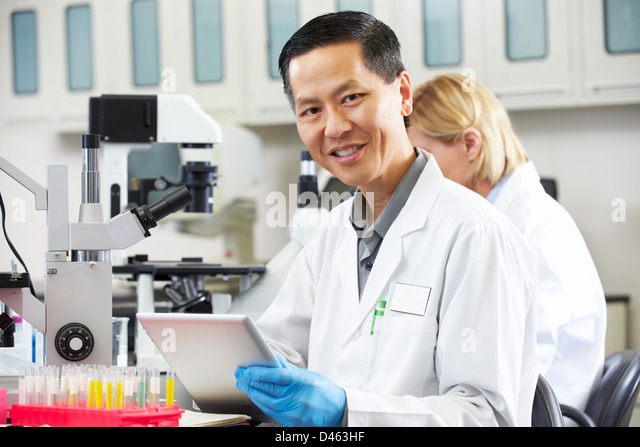 Male Scientist Using Tablet Computer In Laboratory - Stock Image