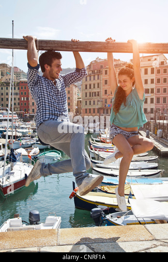 Couple playing on urban pier - Stock Image