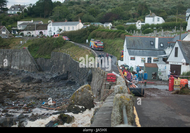 Coverack, Cornwall. 18th July 2017. Residents look on after flash flood in coastal village of Coverack, Cornwall - Stock Image