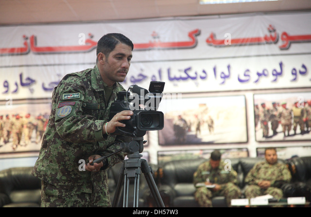 Afghan National Army public affairs soldier records the ANA 203rd Corps Quarterly Training Brief on Forward Operating - Stock Image