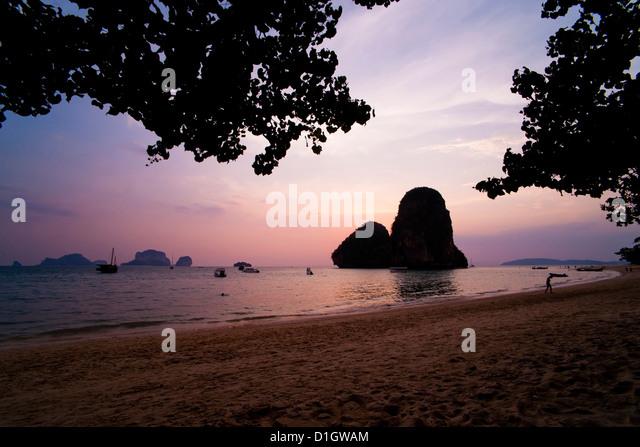 Colourful purple tropical sunset at Ao Phra Nang Beach, Railay (Rai Leh), South Thailand, Southeast Asia, Asia - Stock Image