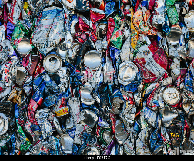 Mass of aluminium cans being processed at a recycling plant. - Stock Image