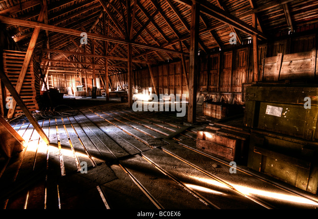 Wooden warehouse with wooden crates - Stock Image