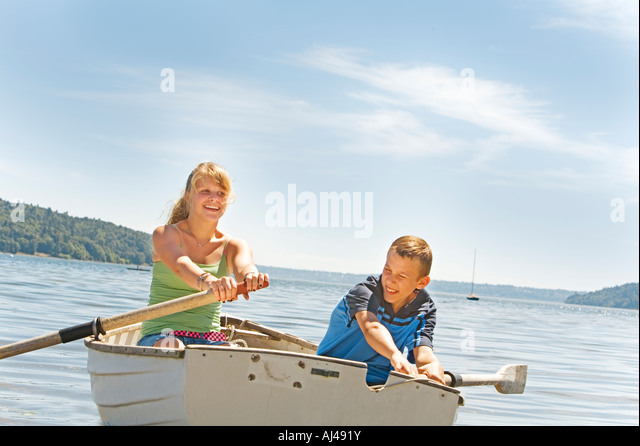 Boy and girl in row boat - Stock Image
