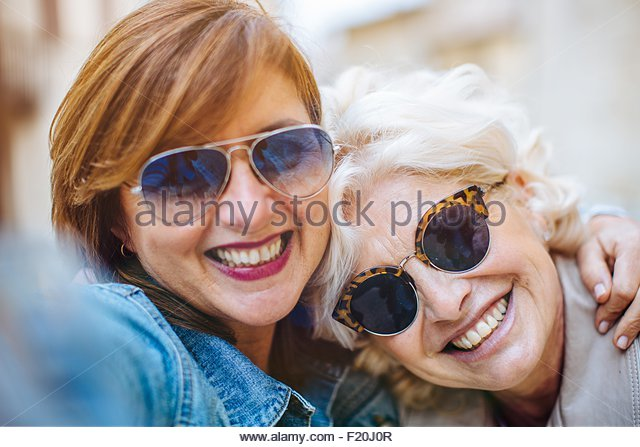 Two mature women posing for selfie - Stock Image