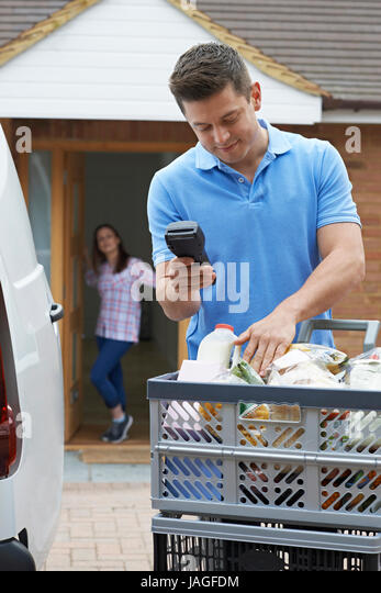 Driver Delivering Online Grocery Order - Stock Image