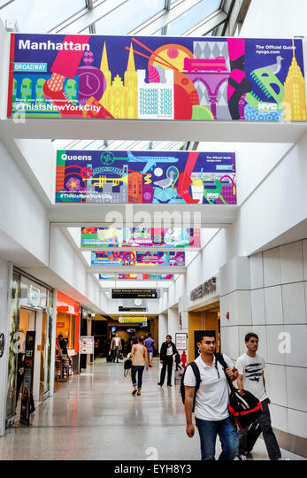New York Queens John F. Kennedy International Airport JFK inside interior terminal concourse gate area promotion - Stock Image