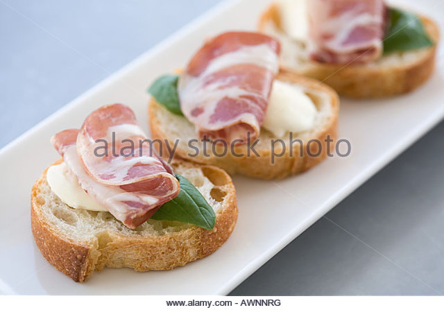 Canapes party stock photos canapes party stock images for Prosciutto and melon canape