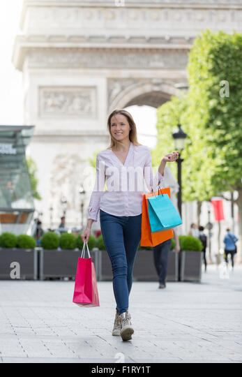 Woman shopping on Avenue des Champs Elysees - Stock Image
