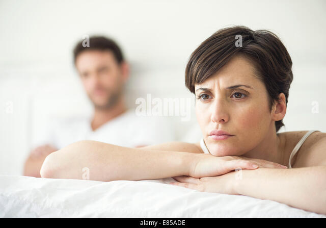 Couple not speaking after disagreement in bed - Stock Image