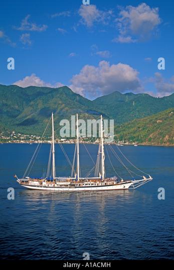 St Lucia  tour boat cruising southern coastline - Stock Image
