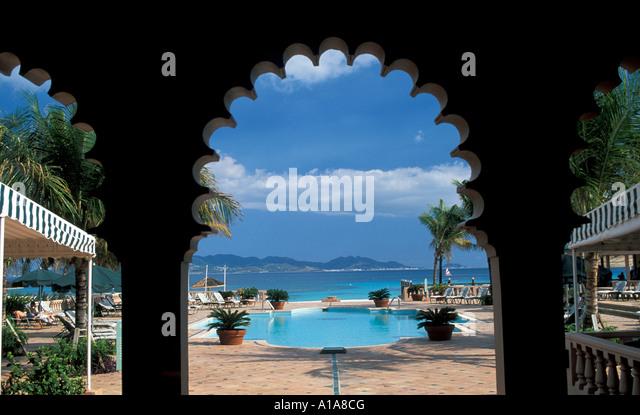 Anguilla hotel swimming pool ornate door - Stock Image