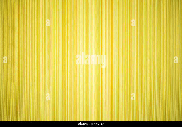 yellow striped textured wallpaper - Stock Image