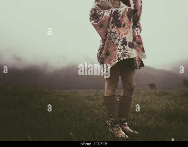 Low Section Of A Woman Standing On Landscape - Stock Image