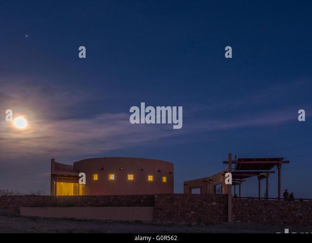 Nearly full moon over Marfa Lights Viewing Center, Marfa, Texas. - Stock Image