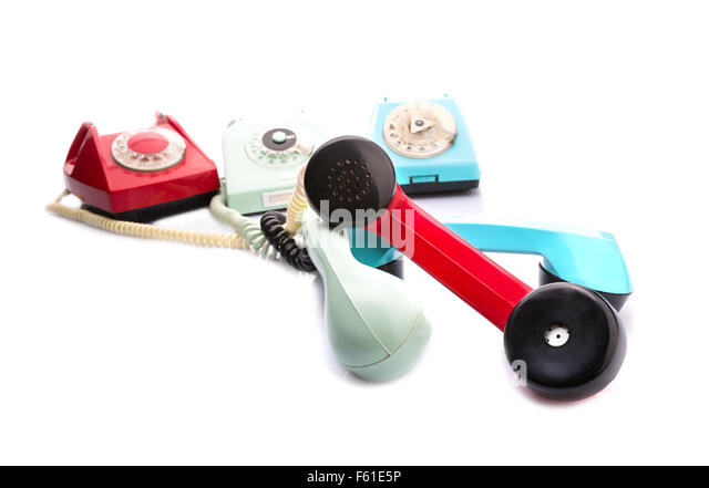 Set of vintage telephones with twisted handsets - Stock Image