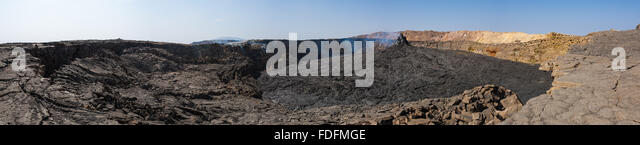 The northern crater of Erta Ale with the still-steaming Hornito at the center of a caldera full of steaming black - Stock Image