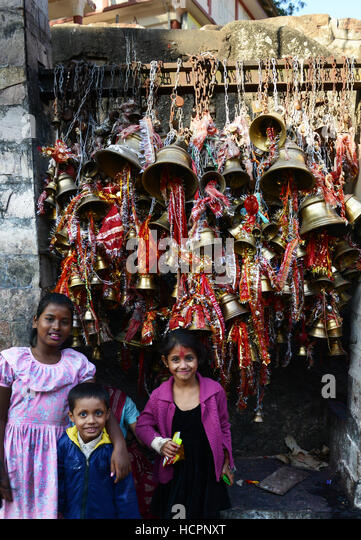 Assamese girls posing for a photo in the Kamakhya temple. - Stock Image