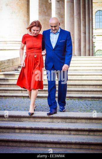 Senior couple walking down staircase, Munich, Bavaria, Germany - Stock-Bilder