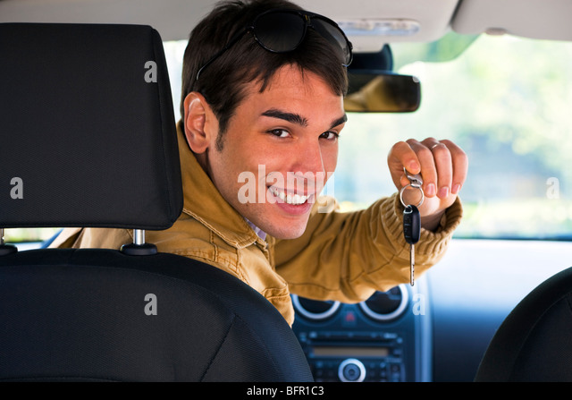 man in car showing car keys - Stock Image