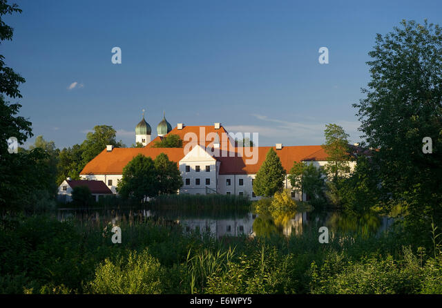 Seeon Abbey reflecting in the lake, Seeon, Chiemgau, Bavaria, Germany - Stock Image