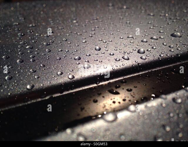 Water beading on car paint - Stock Image