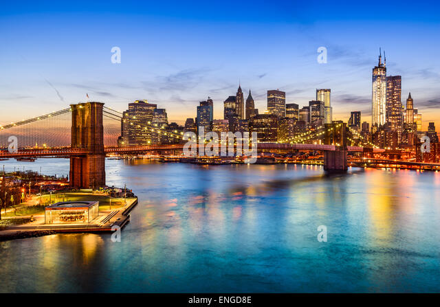 New York City, USA skyline over East River and Brooklyn Bridge. - Stock Image