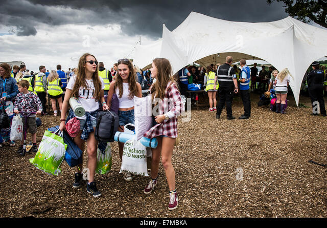 Festivalgoers arriving at the Brownstock Festival in Essex. - Stock Image