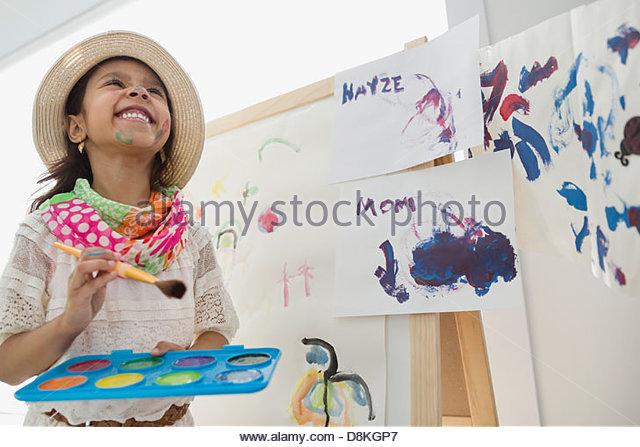 Girl pretending to be artist - Stock Image