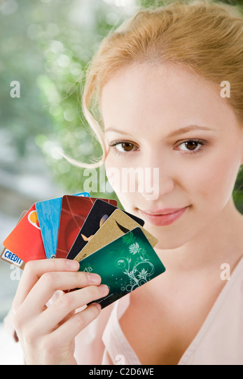 Woman with credit cards - Stock Image