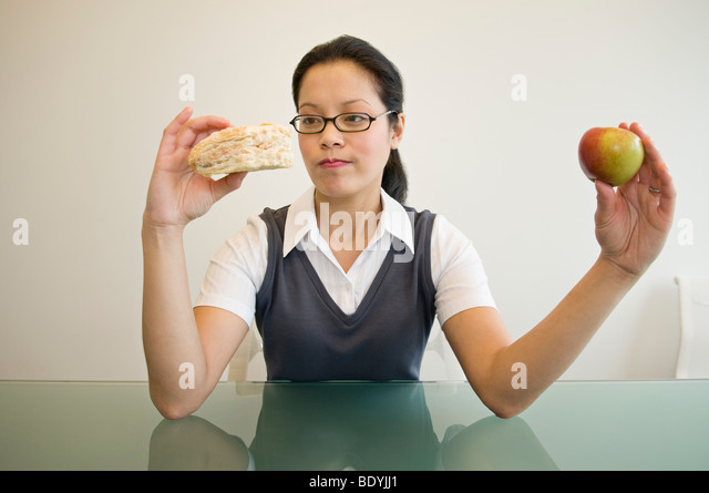 A business woman deciding what to eat - Stock-Bilder