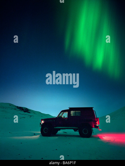 Jeep with Aurora Borealis or Northern Lights, Iceland - Stock Image