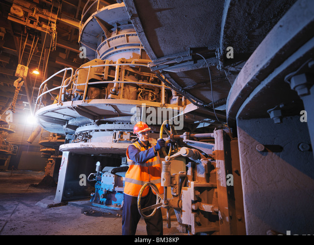 Worker Milling Coal In Power Station - Stock Image
