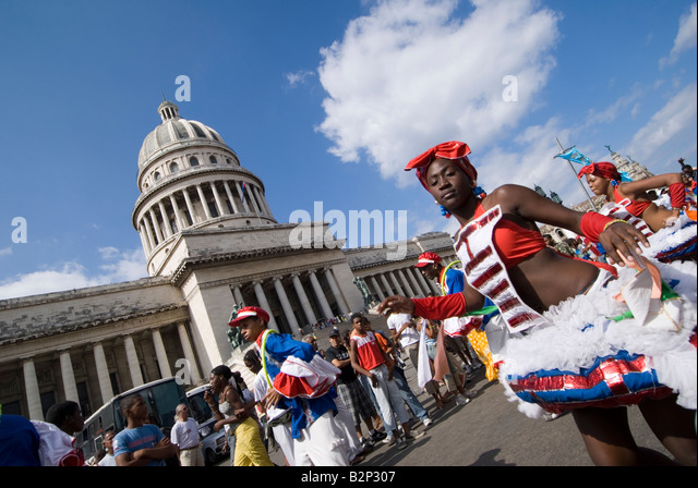 Afrocuban carnival group Los componedores de batea performing in front of the Capitolio in La Habana Vieja Havana - Stock Image
