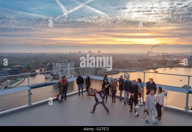 Amsterdam ADAM Lookout Tower observation deck at sunset. View towards western docklands from Amsterdam Noord. A'dam - Stock Image