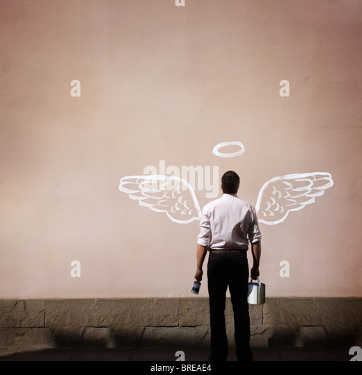 man with angel wings painted on a wall - Stock-Bilder