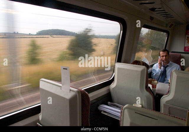 Oct 05, 2004; London, UK; Travellers and passengers on the train from London to Leeds enjoy reading books as the - Stock Image